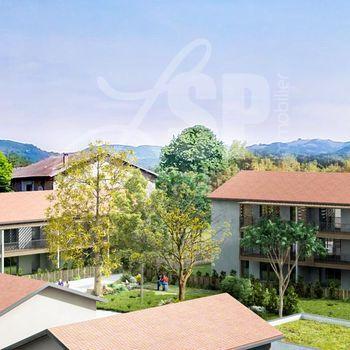 Appartement T3 avec jardin (A001) : Esprit Village