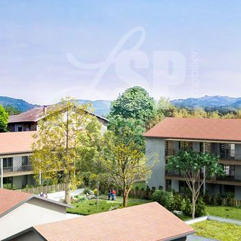 Appartement T3 avec jardin (A002) : Esprit Village